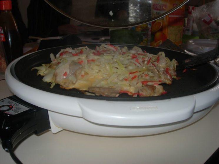 23 okonomiyaki au porc est presque cuit